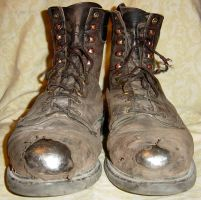 Tattered Old Work Boots by FantasyStock