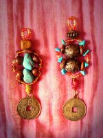 Lucky coin keyrings by moonwolf17