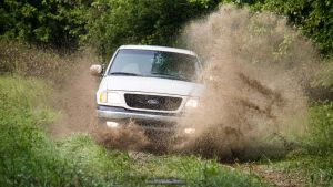 White F-150 in the Mud by joerayphoto