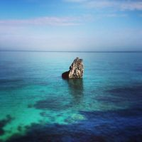 Solo rock in the sea by Natures-Studio