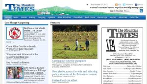 My photo on the cover of the newspaper and website by Champineography