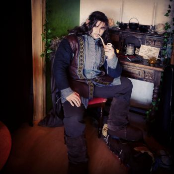 Kili with his pipe in Bag End by IngridBeast