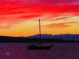 Rainbow Sailboat Sunset by wolfwings1