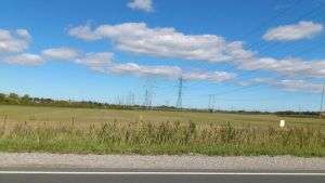 A Field with Powerlines by TheWarRises