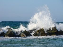 Sunny Rocks in the Sea and Waves Crashing by LuDa-Stock
