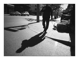 Mystery man and dog by panfoto