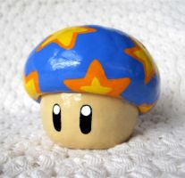 Blue mushroom coin bank by omnomnoms