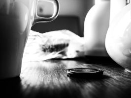 White coffee mug on a wooden table by elDenim