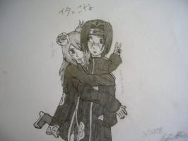 Konan and Itachi by Akatsuki-waffles