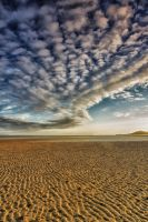 Clouds over the beach by Wanowicz
