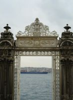The Bosphorus through the Dolmabahce Palace gate by popol-vooch