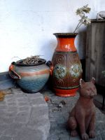 ceramic vases and a cat figure by Mortifiera