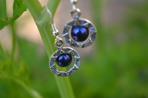 Blue Iris Stargate like charm earrings by lunnybunny1