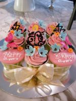 Pink Cupcakes with Gold Ribbon by Sliceofcake