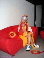 Rikku sitting on  a couch by Vanne