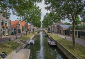 Centered, canal in Medemblik by framafoto