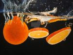 oranges dropped into water by NeilTuOderschvank