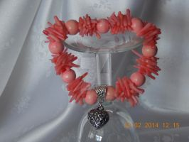 Pink sea coral and wooden bead stretch bracelet by Quested-Creations