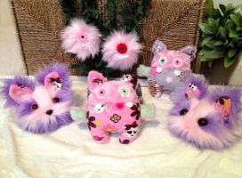 Breast cancer charity creatures by EyepatchNinja