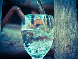 Pouring water in the glass by MattHalic