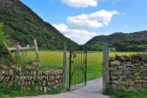 An open gate to Beddgelert  North Wales by gwenoder