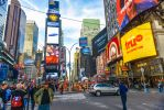 Times Square under the Manhattan sky by Rikitza