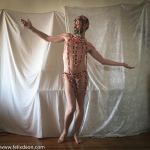 Male nude in a beaded costume 1 by TheMaleNudeStock