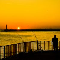 Fisherman at the sunset by Masisus