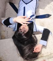 Homura - Laying in the sunlight by Achico-Xion
