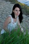 Emma crouched behind grass by wildplaces