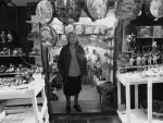 Old lady in shop at San Gregorio Armeno Naples by RerinKin