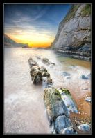 Sunrise along the Dorset Coast by thesolitary