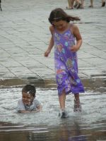 playing in the water. by paolica
