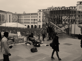 Musician at Mont des Arts (Sepia) by Atlantagirl