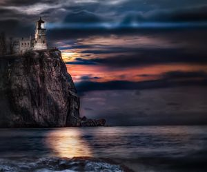Split Rock Lighthouse with Full Moon Rising by AugenStudios