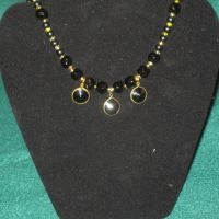 Black and gold necklace by BlackUnicornWood