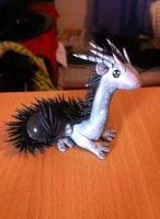 Black and grey spiked dragon with a glass marble by HandmadeDragons
