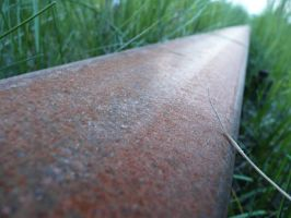 Rusted railway track by Silthria