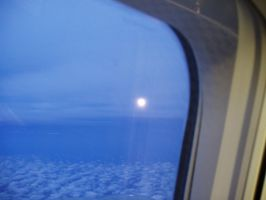 Moonrise at 30,000 ft by Avalonshroud