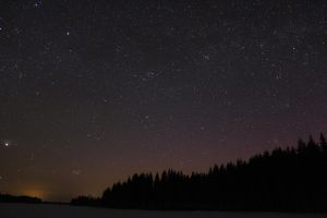 Starry sky over a frozen lake by Antza2
