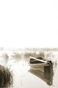 loneliness boat in sepia by RadioUran