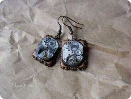 Steampunk earrings with old watch movements by IkushIkush
