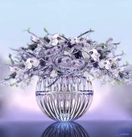 Flower arranging in glass vase by marijeberting