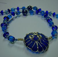Blue wire decorated necklace by dedpplrheavy