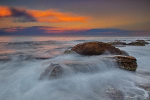 Waves spilling over the rocks by Kounelli1