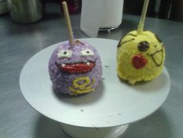 Koffing and pikachu candy apples by DarcKill