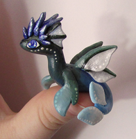 Water 'Thumb' Dragon by KingMelissa