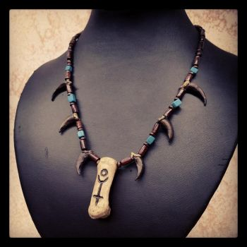 Ploutos claw and bone necklace by Elorhan