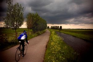 Lonely cyclist by burgerr