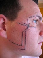 face tattoo by inkfusiontattoo